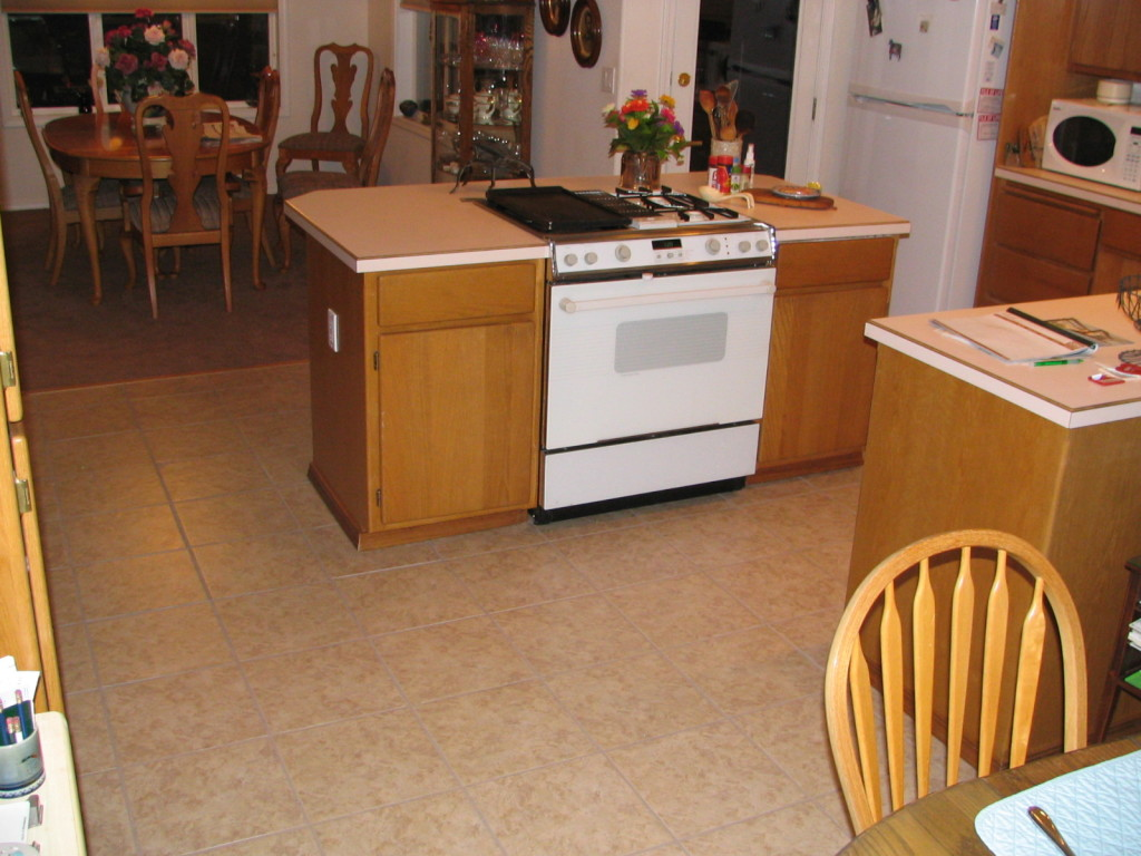 Kitchen tile floor 3600 royal holland inc ceramic tile floor with a custom hardwood carpet to tile transition particle board sub floor was removed to allow tile to finish flush with the carpet dailygadgetfo Gallery